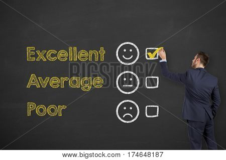 Business Person Drawing Customer Satisfaction on Blackboard Background