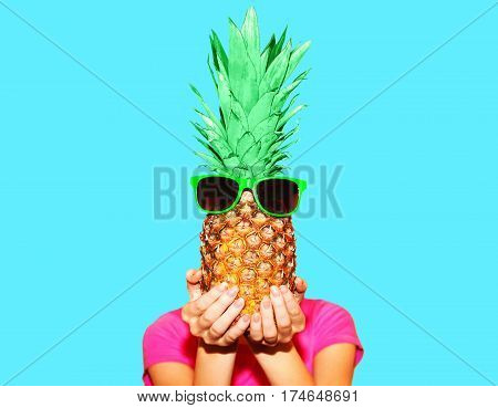 Fashion Portrait Woman And Pineapple With Sunglasses Over Colorful Blue Background
