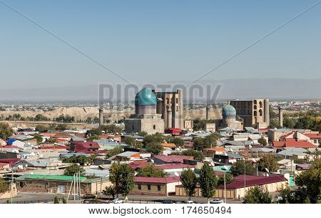 Top view of the monument Bibi-Khanym mosque amid a residential district with one-story buildings. Samarkand Uzbekistan