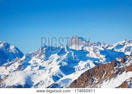 Beautiful winter landscape of snowcapped mountain peaks at sunny day