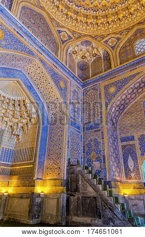 SAMARKAND UZBEKISTAN - OCTOBER 15 2016: Interior of the mosque Tilya Kari Madrasah on Registan Square minbar