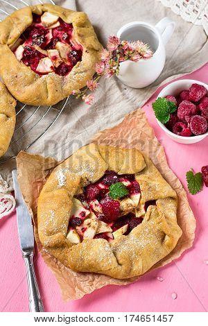 Apple raspberry rustic tart pie with shortcrust pastry