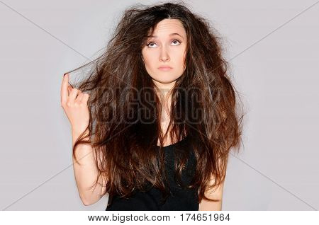 Health And Beauty. Young Woman Looking At Split Ends. Hair Tips Splits. Damaged Hair Long. Close-up