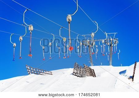 Empty button lifts on the ropeway of ski resort in wintertime