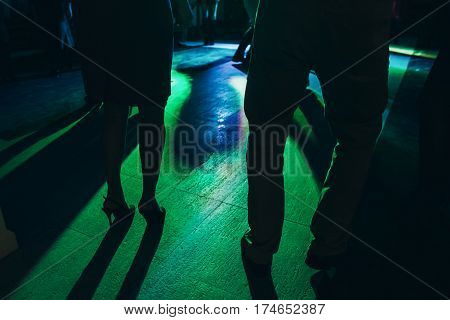 Group Of Happy Fun People Dancing At Dinner Party At Nightclub Disco, Colorful Lights At Corporate R
