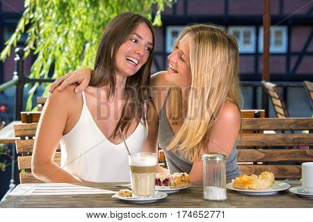 Close Female Friends In Street Cafe