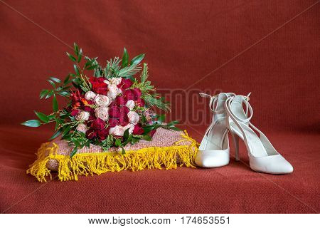 Wedding details. Bride bouquet and shoes. modest wedding