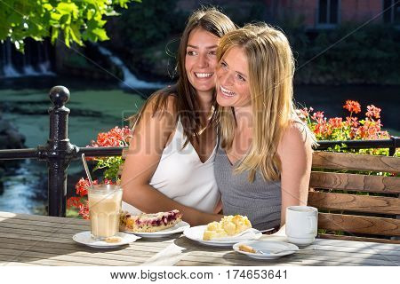 Two Women Friends Hugging And Laughing