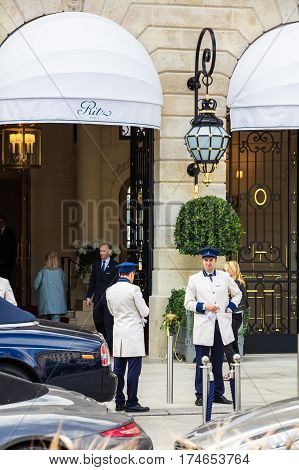 Paris France - July 02 2016: Doormen with uniform meet tourists at the entrance to the Ritz Paris hotel in the heart of Paris on Place Vendome. The hotel is ranked highly among the most prestigious and luxurious hotels in the world.