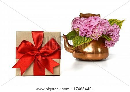 Gift box and flowers isolated on white background