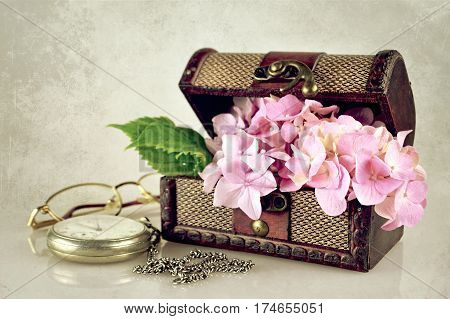 Flowers in the treasure chest on grunge background