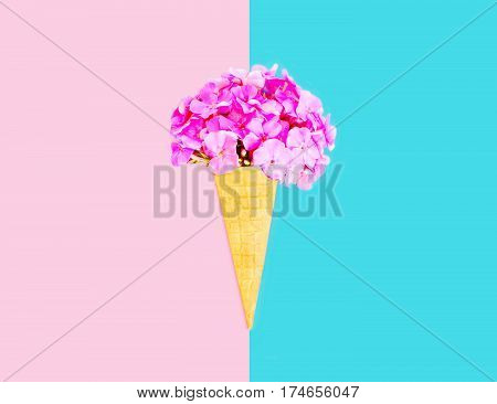 Ice Cream Cone Flowers Over Pink Blue Colorful Background Top View