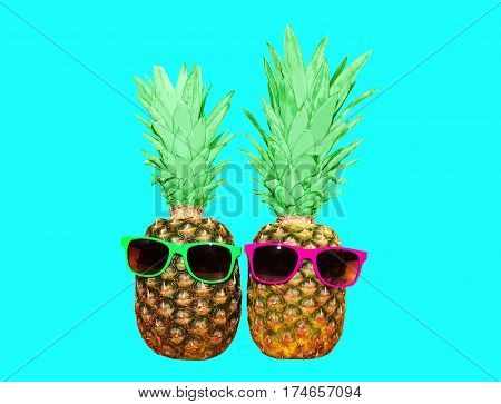 Two Pineapple With Sunglasses On Blue Background, Colorful Ananas Photo