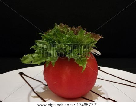 Healthy tomato salad stuff with lettuce and tuna stylist food fusion food Close-up black isolate background