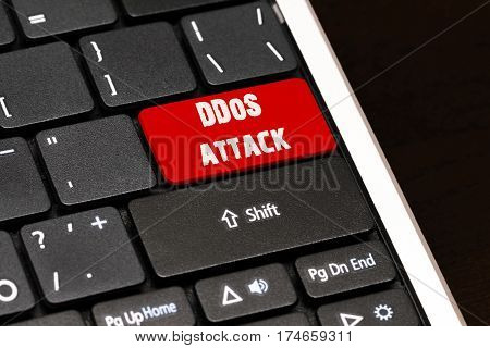 Ddos Attack On Red Enter Button On Black Keyboard