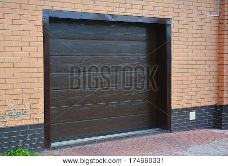 House garage door with plastic garage ventilation outdoor.