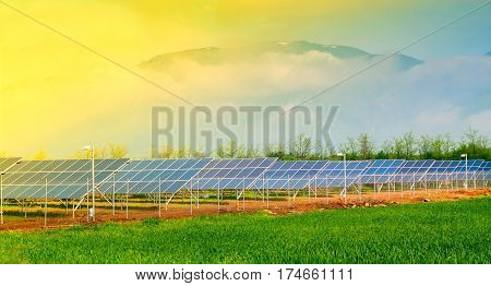 Flat plate solar collectors - solar tribune. Photovoltaic solar collectors in photovoltaic power plant poster