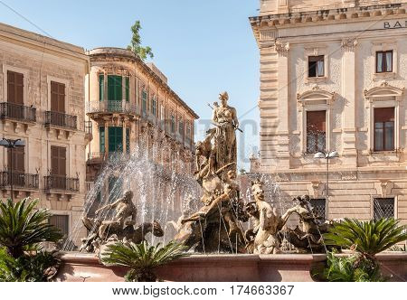 The fountain on the square Archimedes in Syracuse. In the center of the fountain is a magnificent statue of Diana - hunter surrounded by sirens and tritons. Sicily Italy