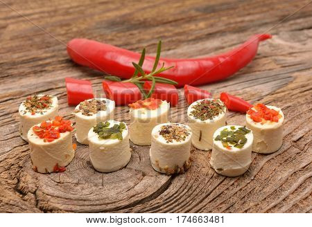 Feta cheese cubes with rosemary twig on wood