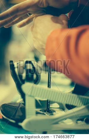 Snowboard Repair Shop Worker Adjust The Bindings