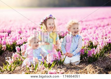 Kids Playing In Flower Field