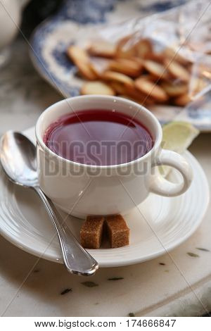 berry tea with lime and biscuits in the cafe