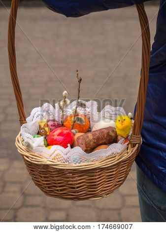 A basket with Easter food eggs chick bread sausage
