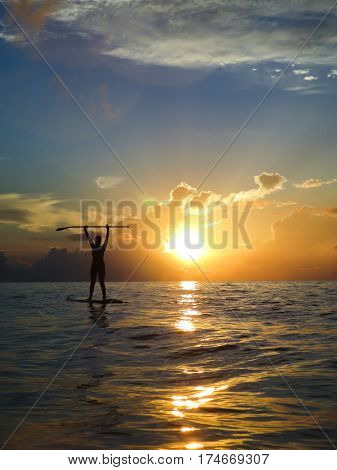 Woman paddle boarding in the Caribbean, Playa del Carmen, Mexico