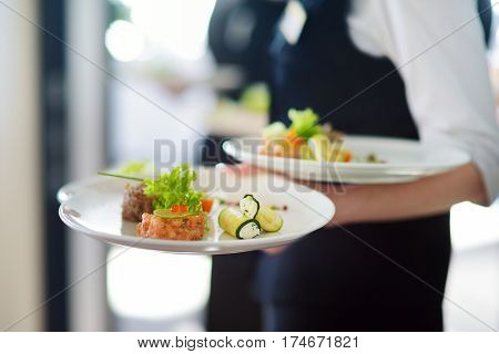 Waiter Carrying Plates With Meat Dish On Some Festive Event