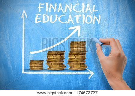 Financial education concept with piles of money and exponential growth chart on blue chalkboard
