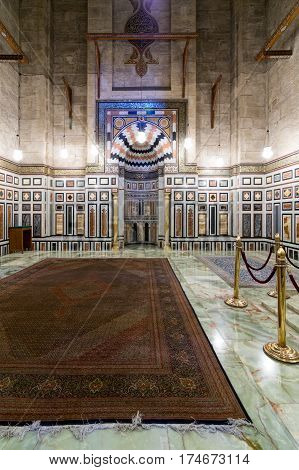 Cairo, Egypt - February 18, 2017: Interior of the tomb of the Reza Shah of Iran, Al Rifaii Mosque (Royal Mosque), located in front the Cairo Citadel, constructed between 1869 and 1912