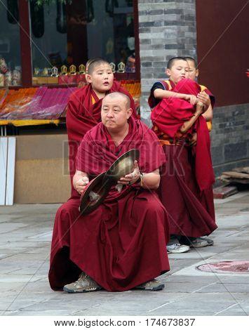 Hohhot, Inner Mongolia - Jul 12, 2010: Buddhist Monks Preparing For The Annual Holiday Presentation