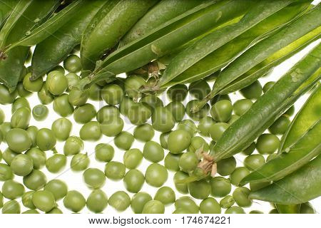 Fresh Raw Green Peas And Empty Pods On White Background