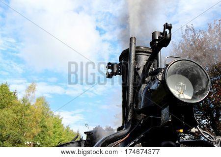 black old steam locomotive detail in action