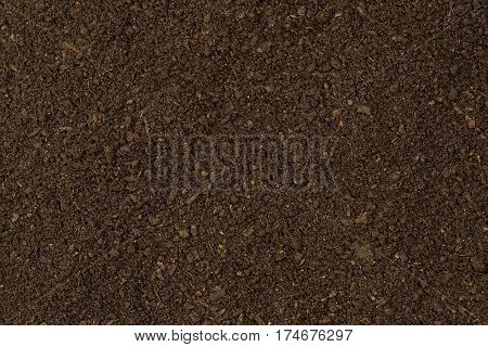 Black dirt texture close up as background