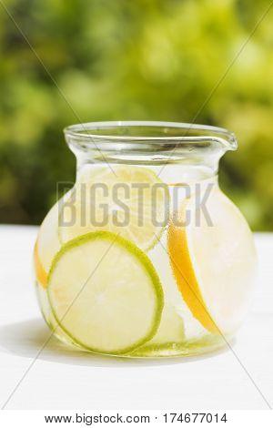 Detox drink with lemon in a jug