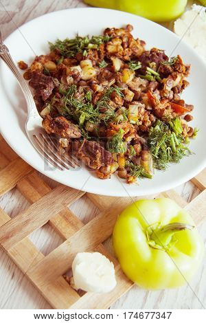 fried ragout with sliced beef, potato and vegetables