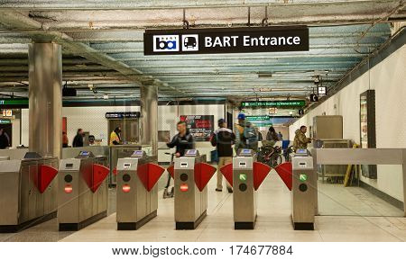 San Francisco CA - March 01 2017: Entrance gates to Powell Street BART Station. Bay Area Rapid Transit (BART) carries commuters to and from San Francisco the East Bay and San Mateo County.