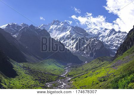 snowy mountain peaks and green valleys Caucasus