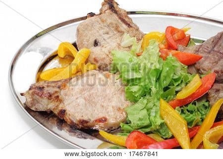 Barbecue on a plate isolated over white