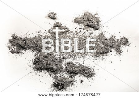 Bible word written in grey ash dust and cross drawing as religion apocalypse god christian gospel faith spirituality concept lent background