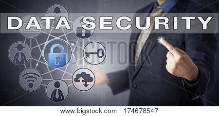 Male enterprise information officer in blue suit testing DATA SECURITY for corporate users. Business concept and technology solutions metaphor for the structured protection of sensitive information.