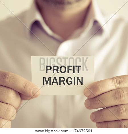 Businessman Holding Profit Margin Message Card