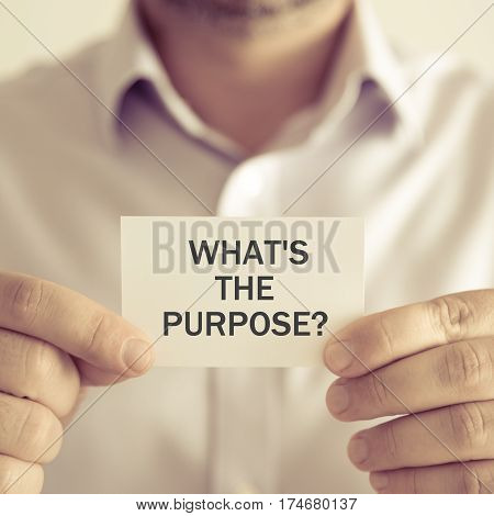 Businessman Holding What Is The Purpose ? Message Card