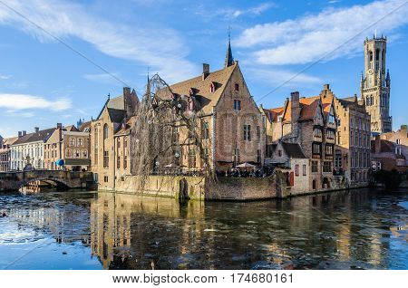 GHENT, BELGIUM - JANUARY 29, 2017: Reflection of the Rosary Quay in the frozen canal in the UNESCO World Heritage Old Town of Bruges Belgium