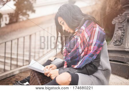 Woman Outside Looking Map