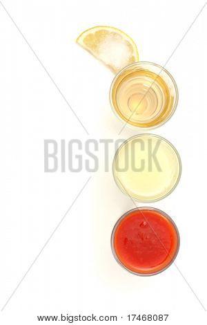 Tequila, Lemon Fresh, Tomato Fresh and Salt on Slice of Lemon. Isolated on White Background.