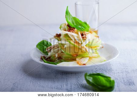 Fresh Fennel and apple salad on a white plate