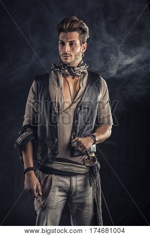 Good Looking Young Man in Pirate Fashion Outfit on Gray Background. Captured in Studio.