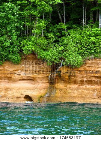 Small waterfall flows into Lake Superior at Pictured Rock National Lakeshore in Michigan.